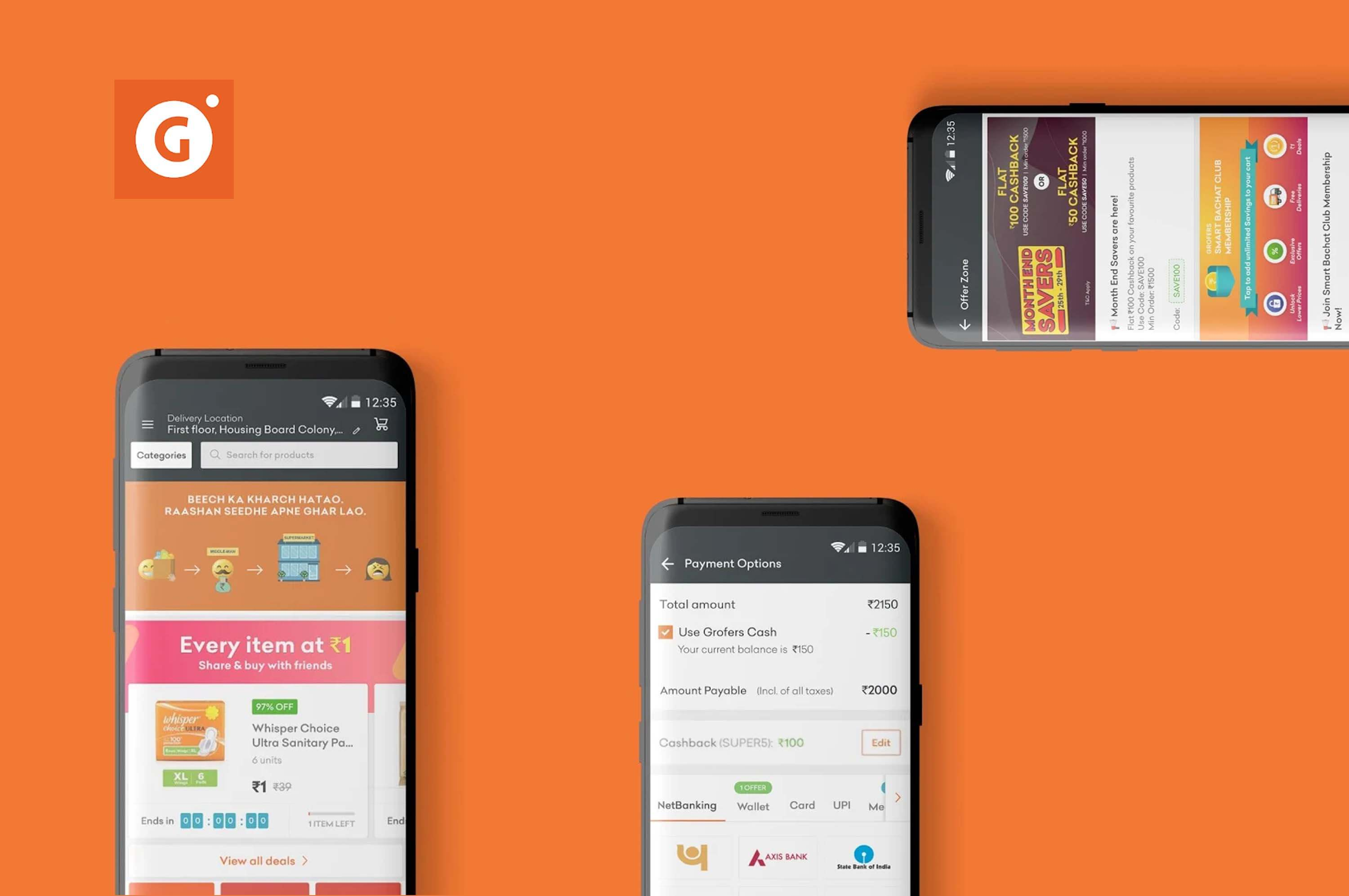 three smartphones opened grofers app in an orange background