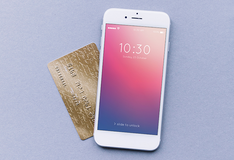 a white iphone and a gold credit card
