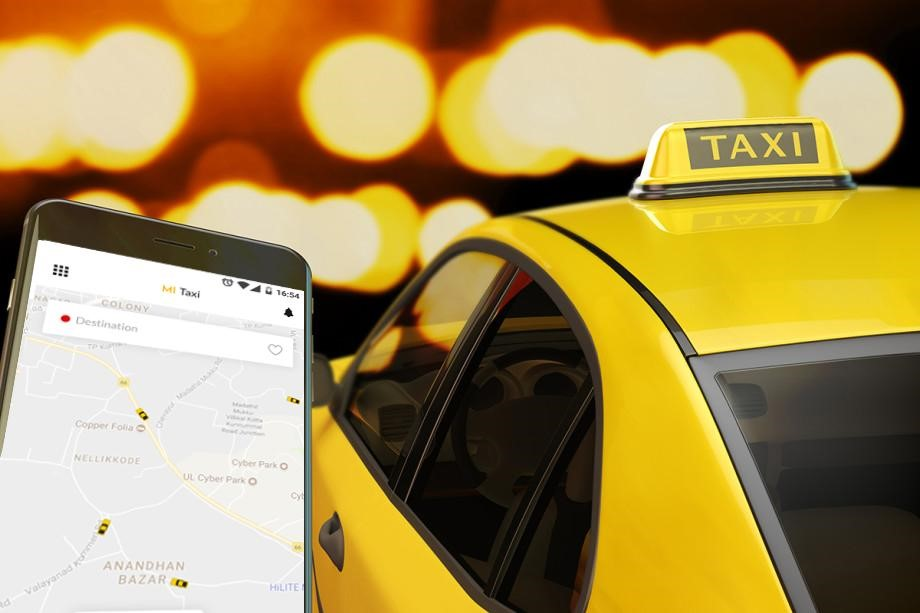 a mobile with a taxi booking app and a taxi besides it