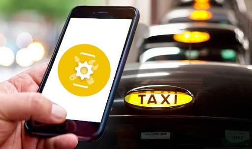 a smartphone and a taxi car