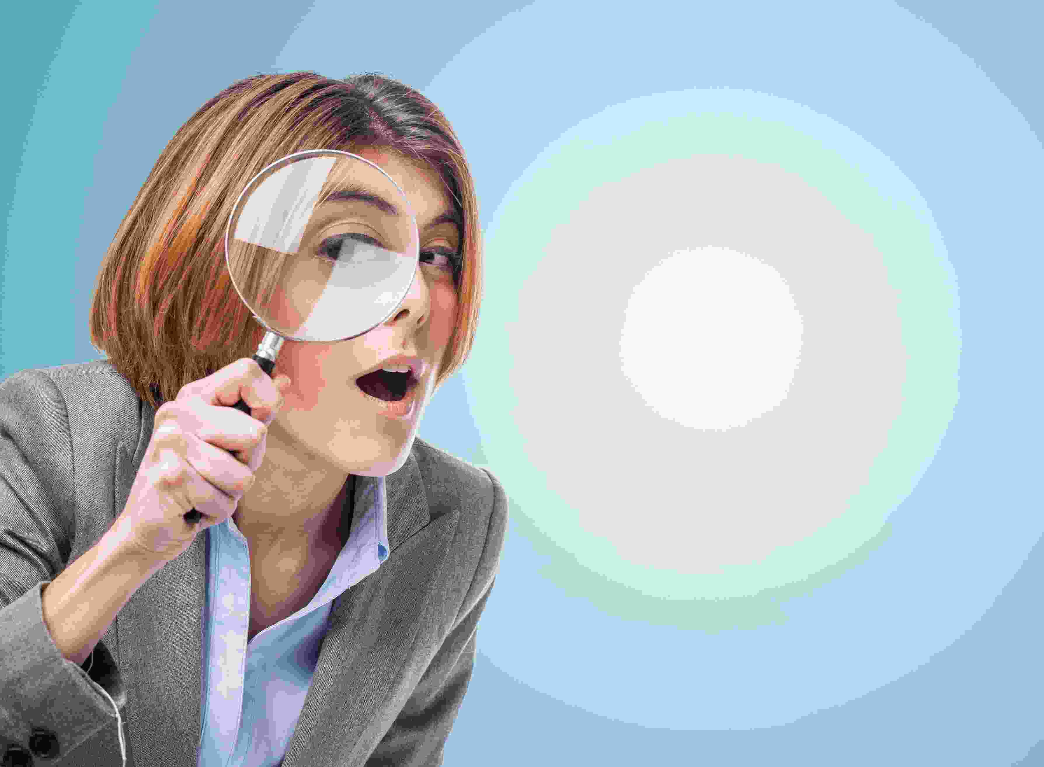 a lady with a magnifying glass